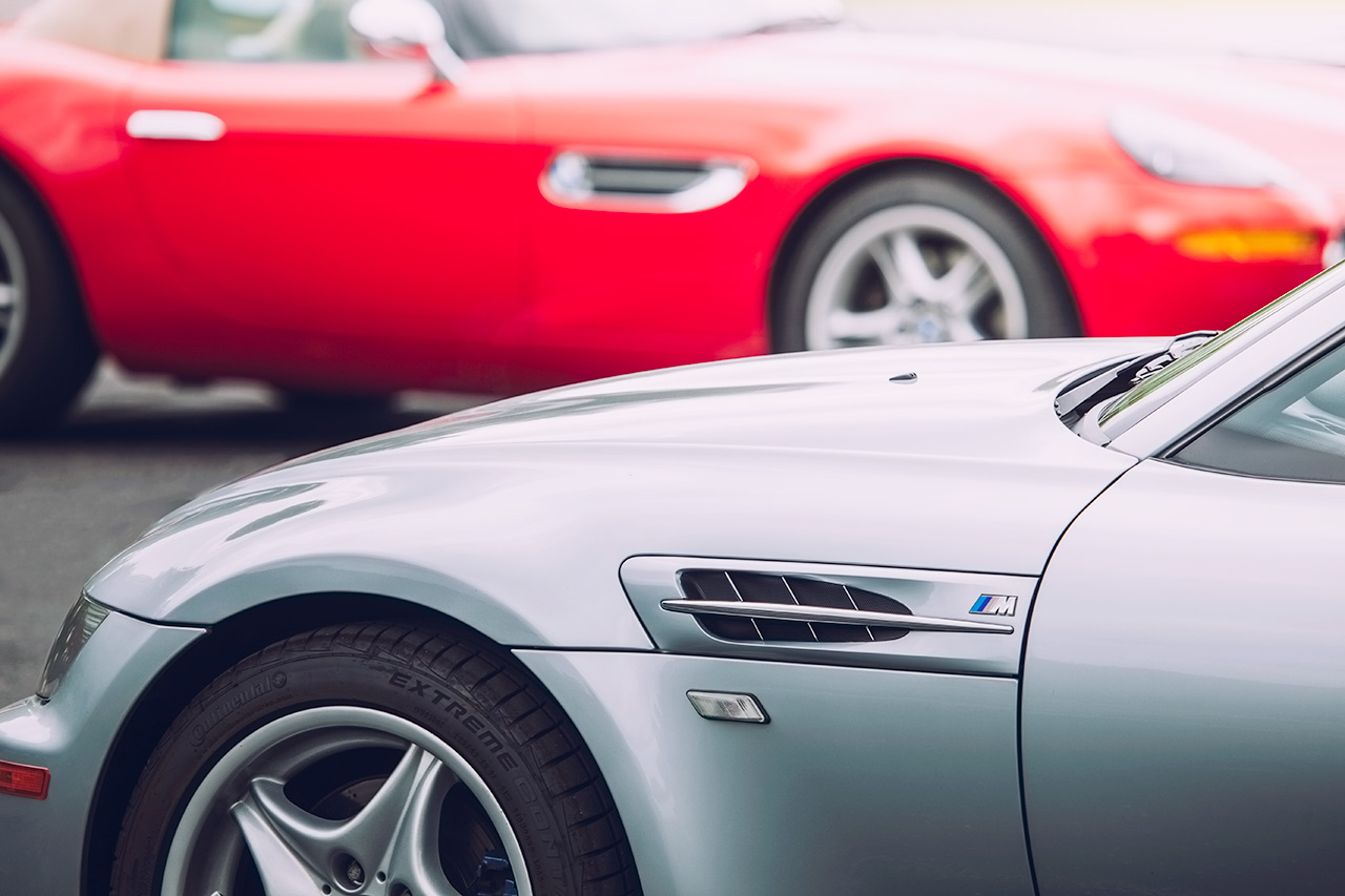 Silver BMW Z3 M Coupe and red BMW Z8