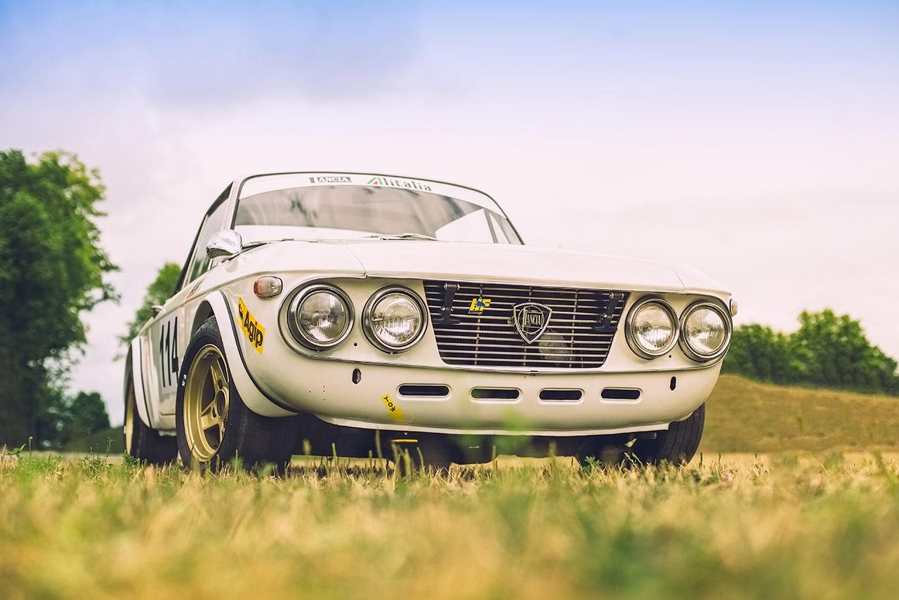 White classic Lancia Fulvia HF rally car