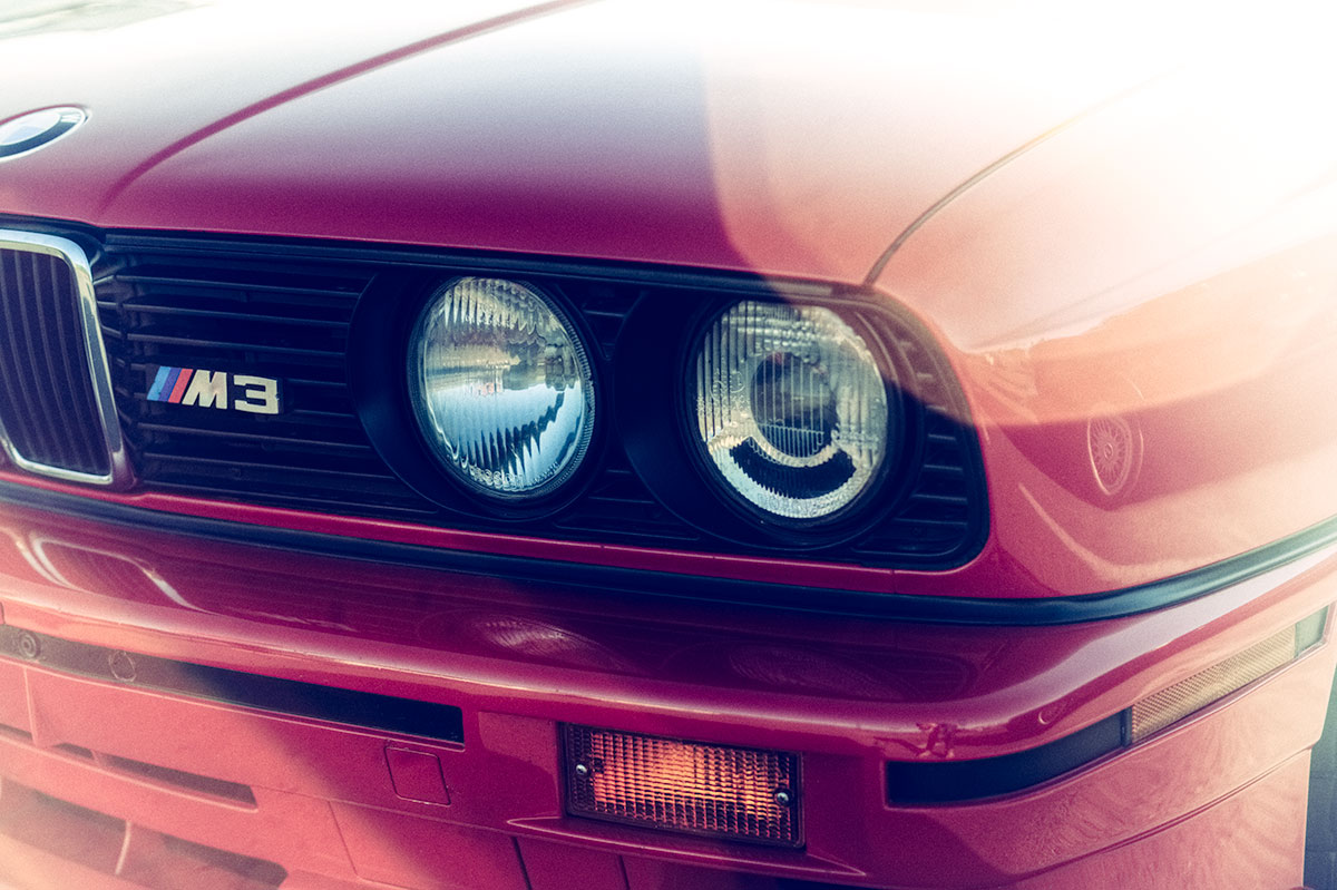 Red BMW E30 M3 flare car photo from Burbbble