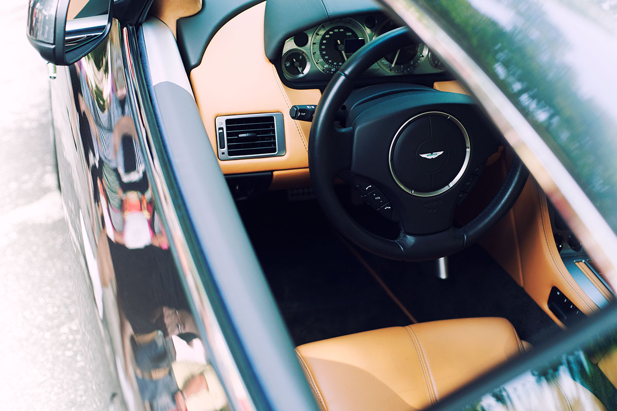 Aston Martin DB9 Tan Interior Steering Wheel car photo from Burbbble