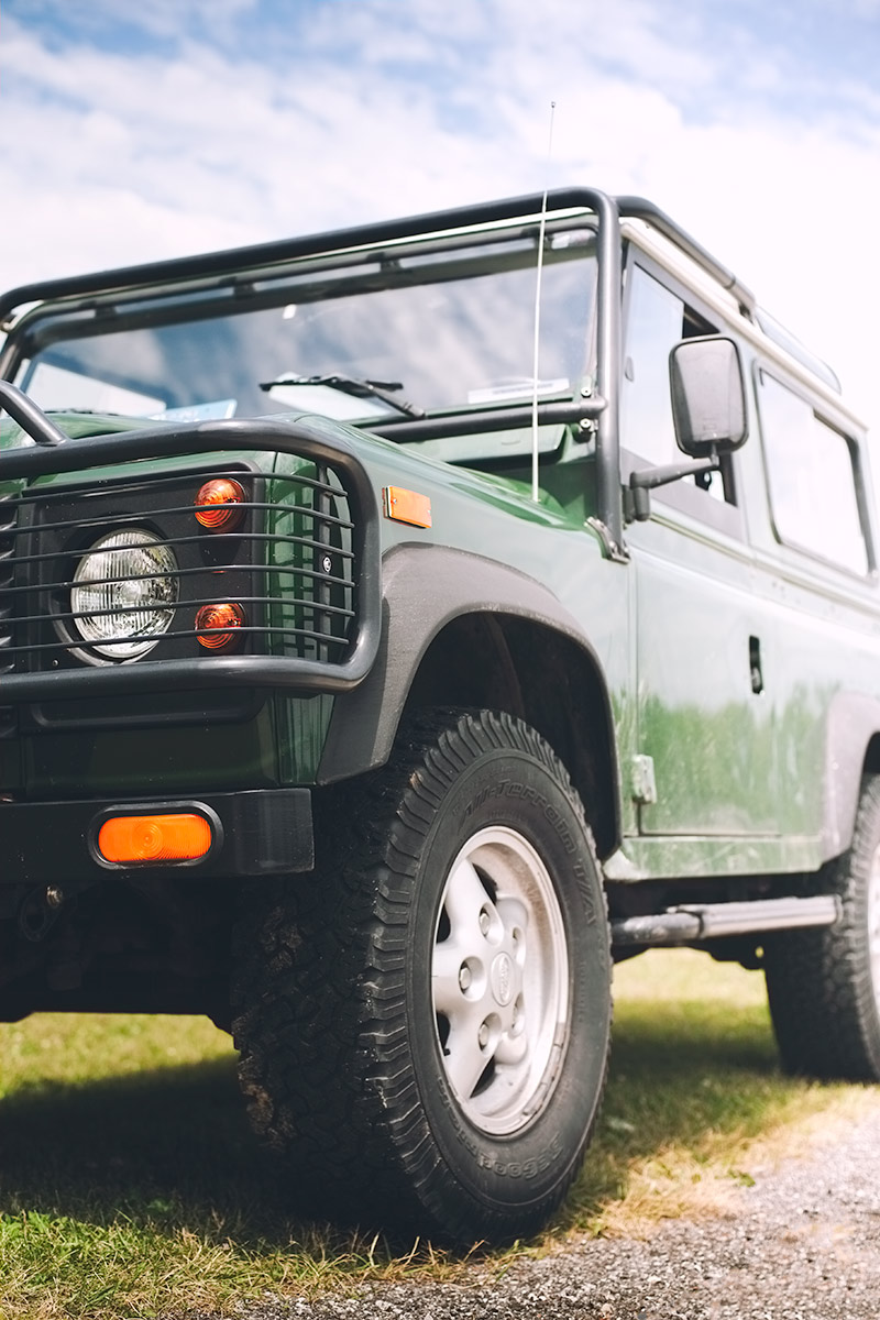 British Racing Green Land Rover Defender car photo from Burbble