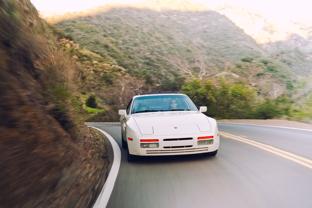 White Porsche 944 Turbo (951) driving through the hills of Southern California