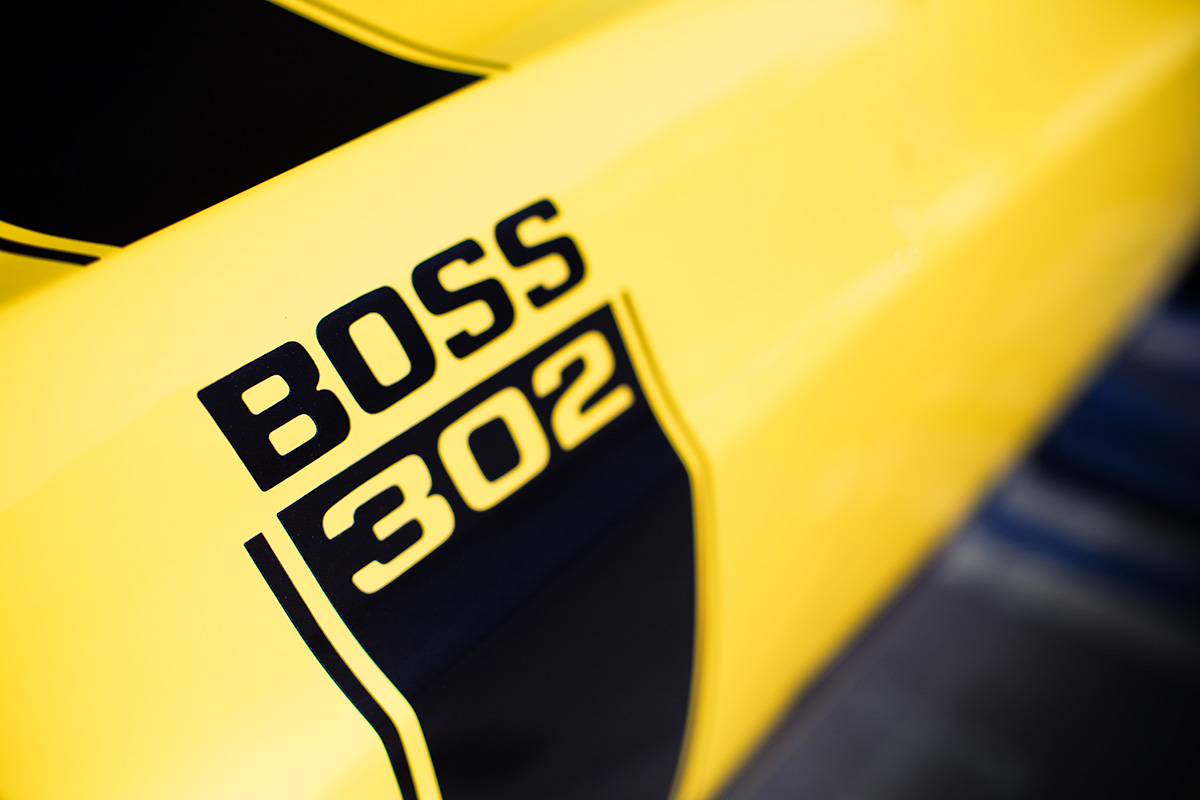 Yellow classic Ford Mustang Boss 302 muscle car photo from Burbbble