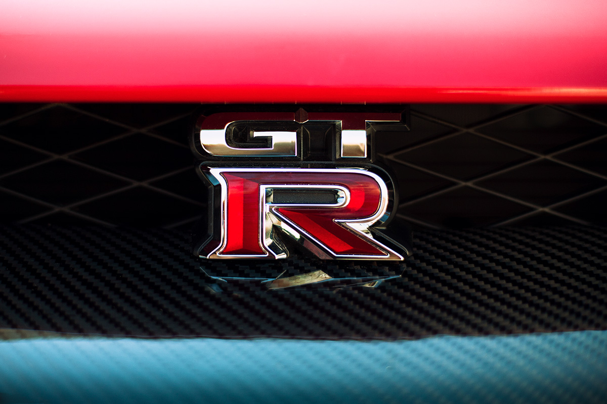 Red Nissan GT-R emblem and grill wallpaper