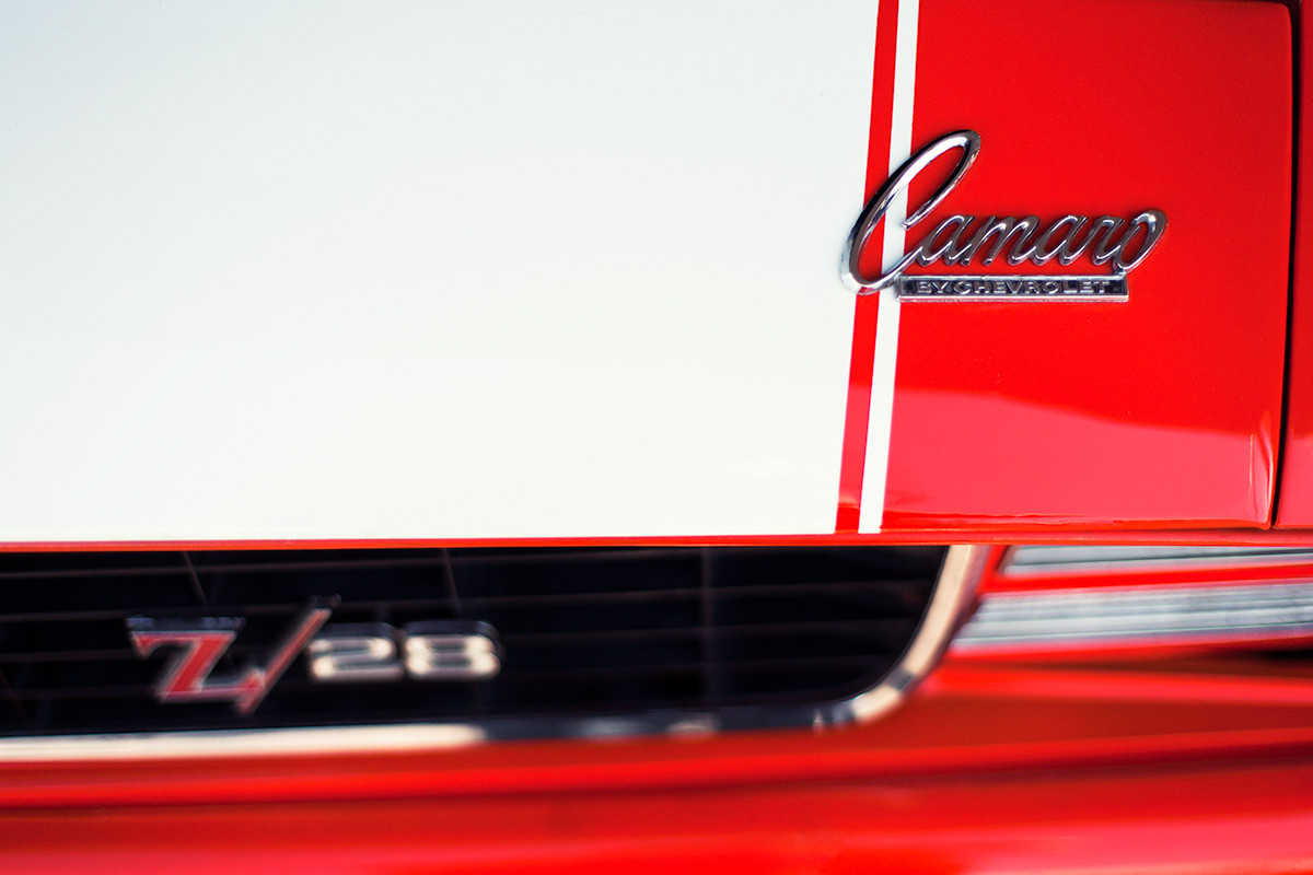 Classic 60s muscle car red Camaro Z28 by Chevrolet